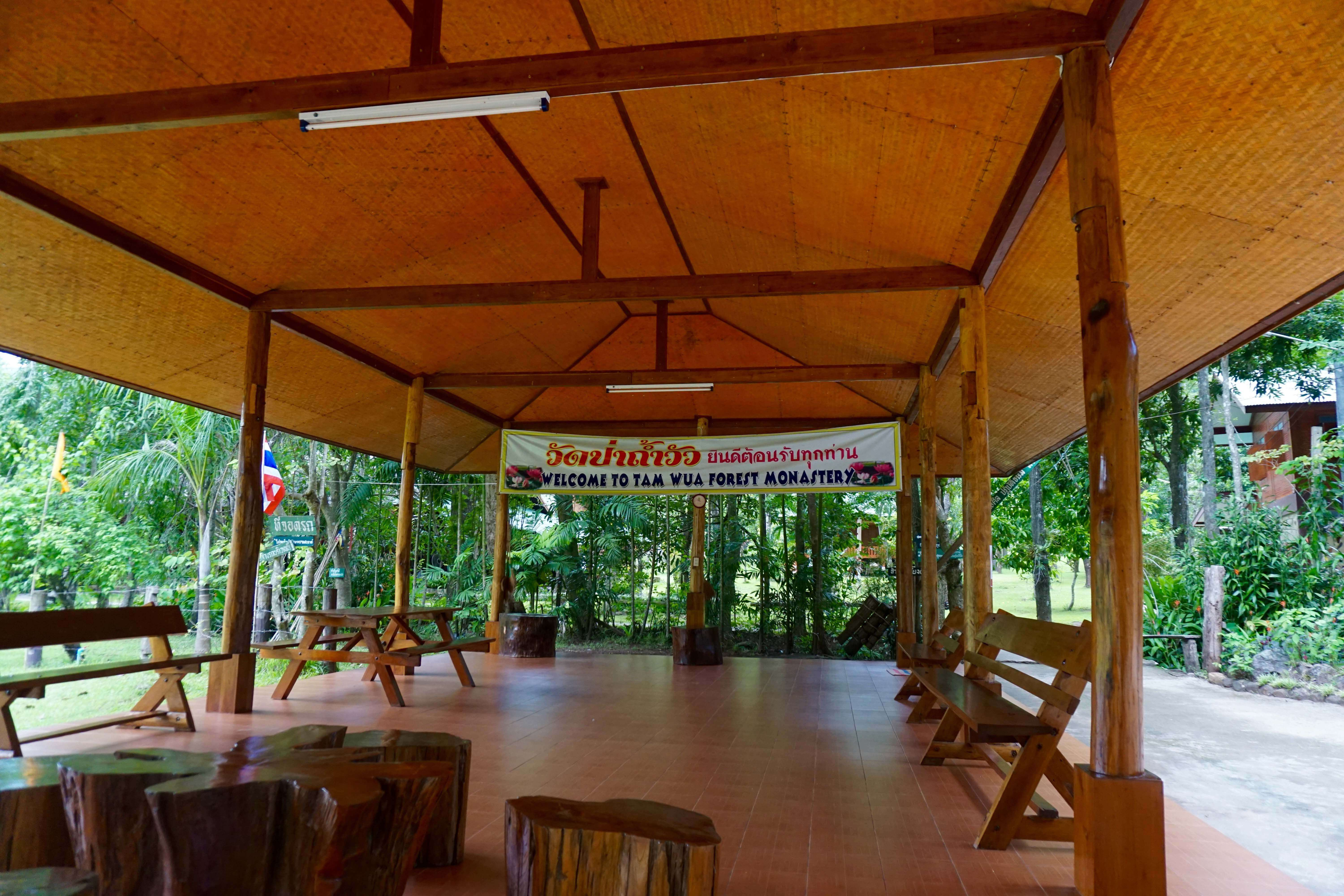 Building in the forest with wood benches and tables