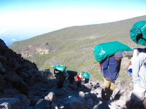 Porters with huge packs