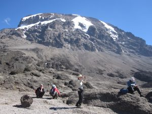 Guides sitting while trekkers take pictures