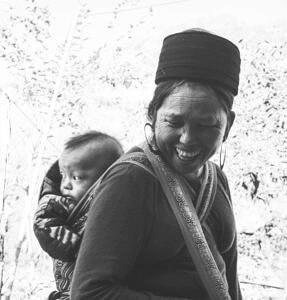 Vietnamese women smiling with her baby