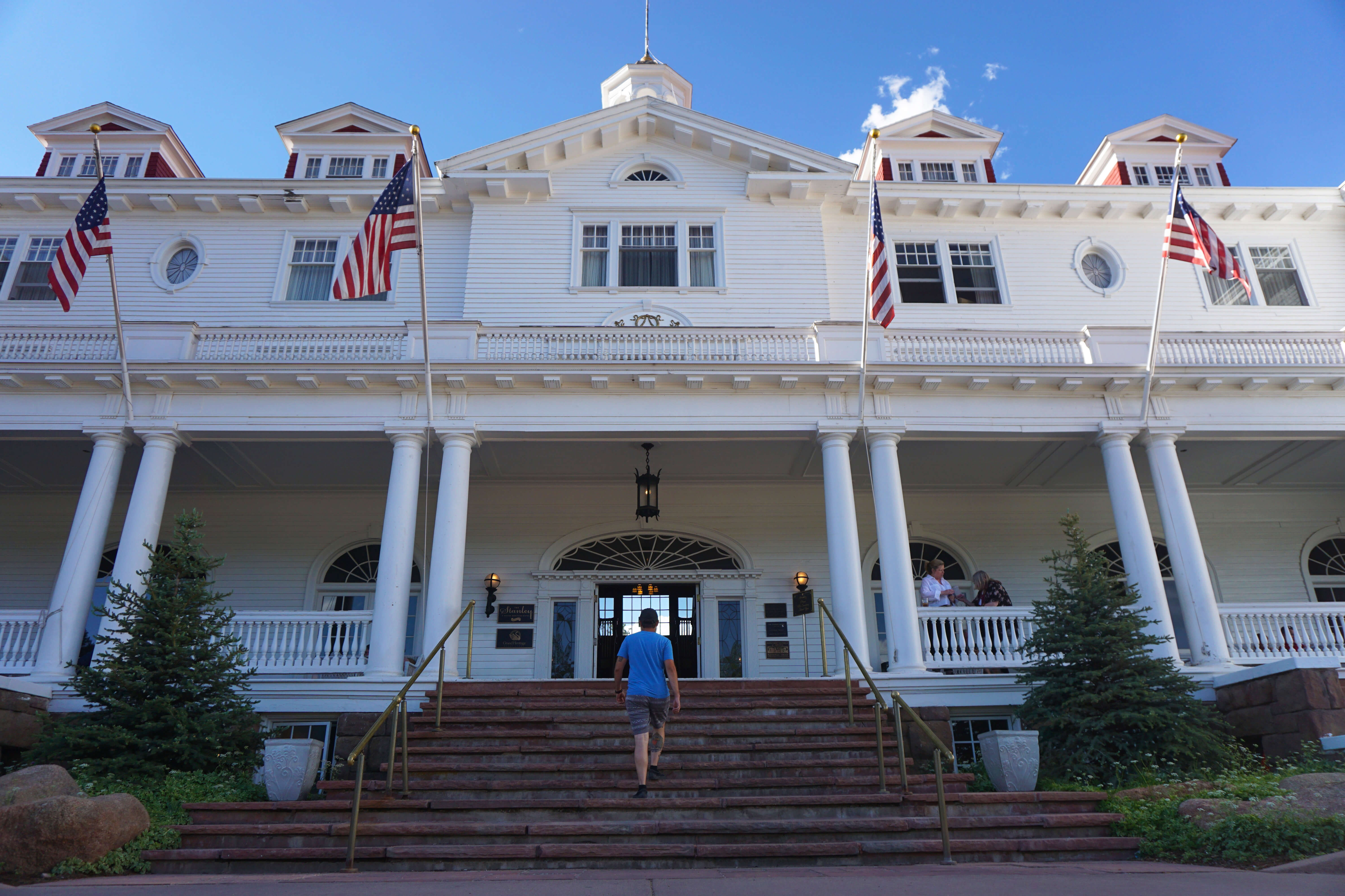 Ron walking up the front stairs of The Stanley Hotel