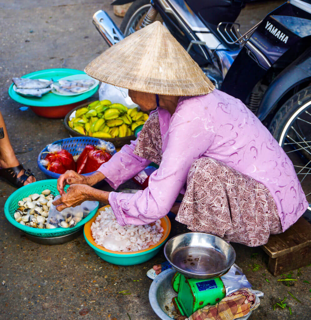 Lady serving food on the street
